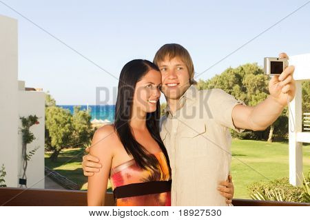 Young couple taking a photo of themselves