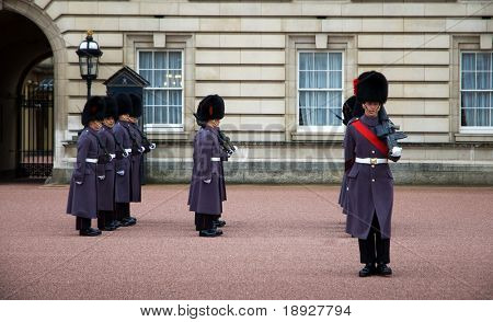 LONDON - NOV 17: Soldiers march as they participate in the Changing of the Guards at Buckingham Palace on November 17, 2008 in London, England. This tradition has taken place since 1660.