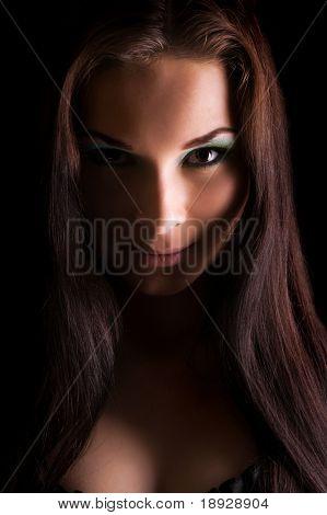 Young beautiful woman's dramatic light portrait