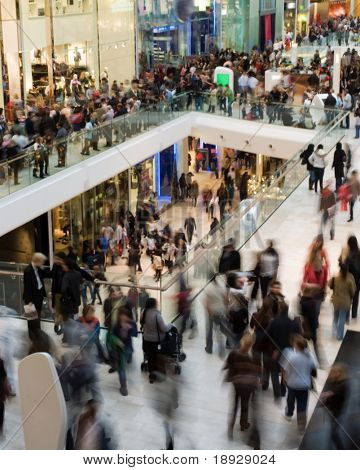 Crowd in the mall (motion blurred)