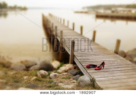 Red Shoes On A Dock