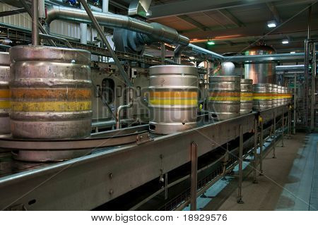 Beer kegs on the production line in the factory