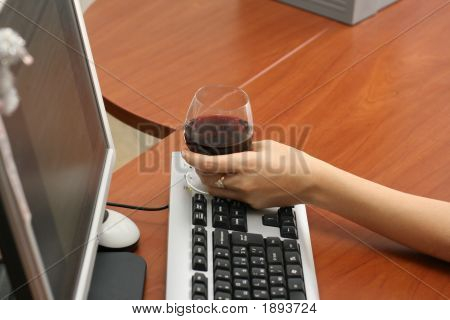 Wine On The Keyboard Of A Computer