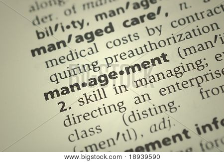 the word management from the dictionary showing a shallow depth of field