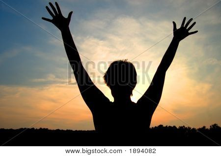 Woman Silhouetted By Sun