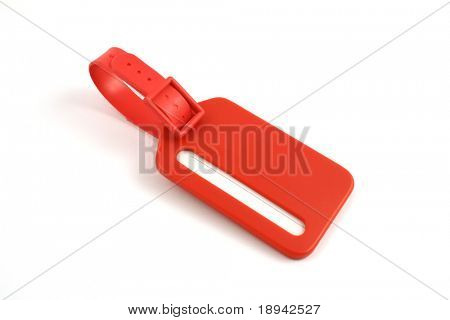 red plastic luggage label close up isolated