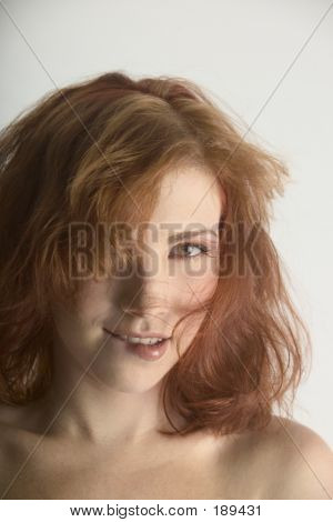 Woman Biting Her Lip With Mussed Hair