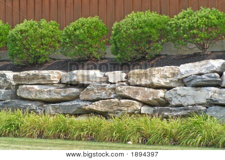 Commercial Planting With Boulder Wall