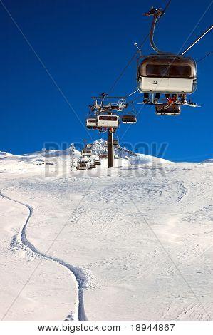 Chair-lift and ski slope; high mountain, winter ski area, Zermatt; Swiss.