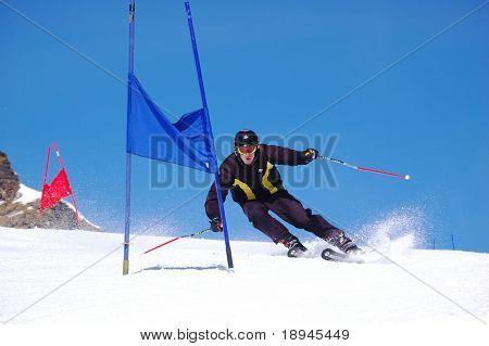 Young ski racer doing downhill slalom