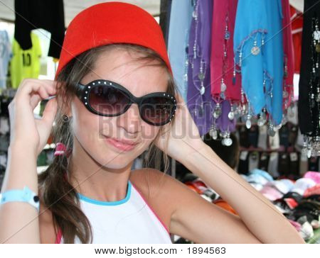 Young Woman Trying On The Traditional Hat Worn In Turkey - Fez
