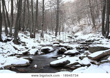 mountain frozen torrent, winter season, horizontal orientation