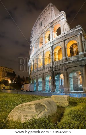 Colosseum arena, night view, vertical frame. Rome, Italy.