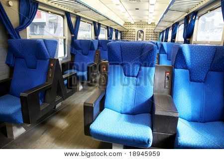 Vacant seats inside an empty passenger train. Horizontal frame.