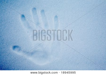 Snow with an impression of a handprint; cold tone.