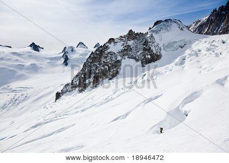Male skier moving down in snow powder; envers du plan, vall?e blanche, Chamonix, Mont Blanc massif, France, Europe.