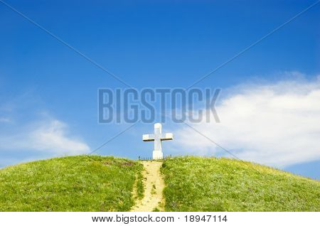 path to the cross on the top of green hill