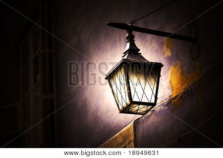 Retro street lamp shining at night