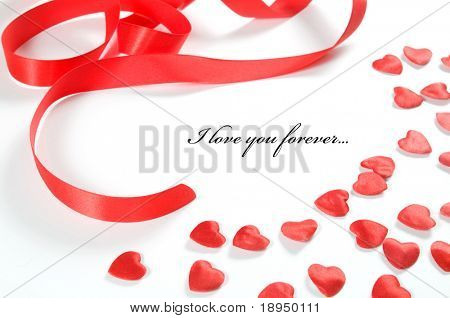 Small red hearts and ribbon on white background. Composition for themes like love, valentine's day, holidays with space for your text