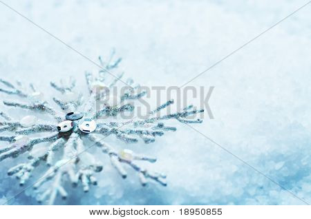 Frosty snowlake in snow Christmas decoration background