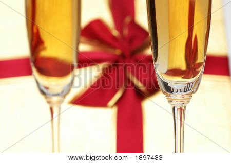 Wine Glass And Giftbox At The Background