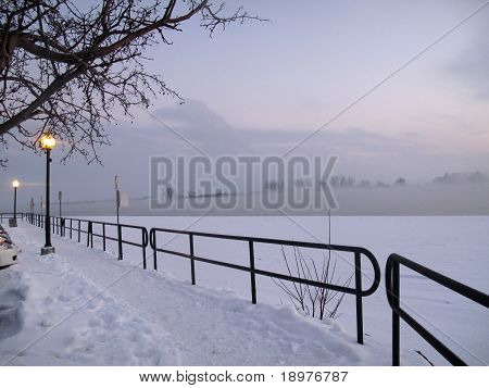 Lamplight on winter walkway