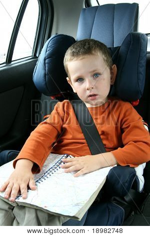 little boy in car safety seat