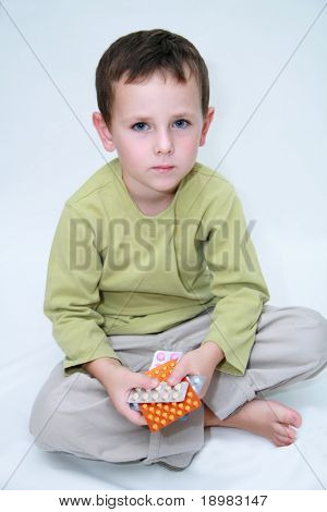 Child holding pills in hands