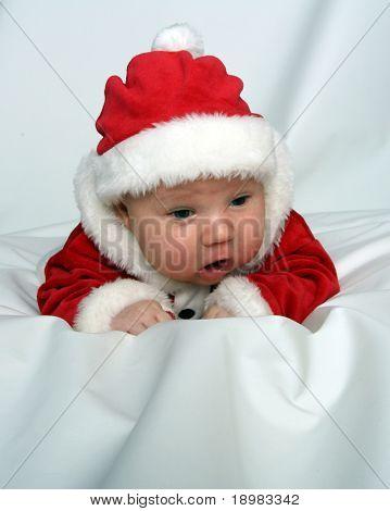 Newborn baby dressed in santa claus costume
