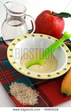 Baby semolina, jug of mineral water, fresh fruits ? healthy infant food.