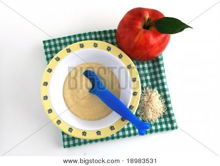 Baby semolina, fresh fruits - healthy infant food.