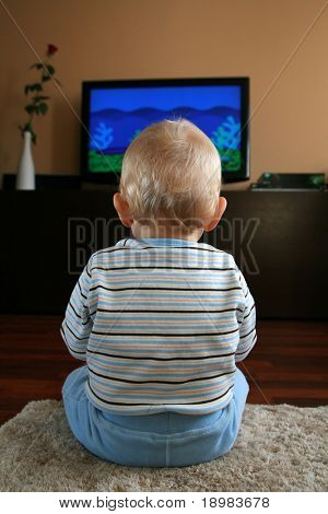 11 months old baby boy watching television