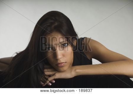 Sad Young Woman Looking At The Camera
