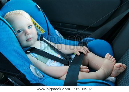 9 months old baby boy in a safety car seat.