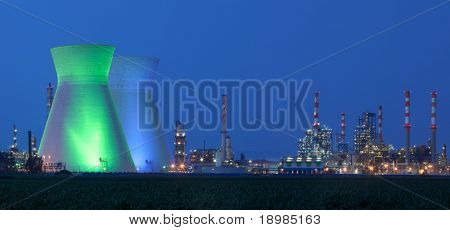Panorama of power station at night under blue sky / Panoramic shot power station at night