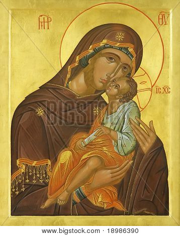 Icon of Madonna Mother of God (Mary) and child (Jesus Christ) on mahogany and gold