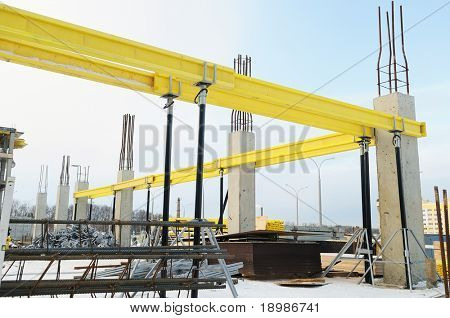 construction equipment at building site of modern house