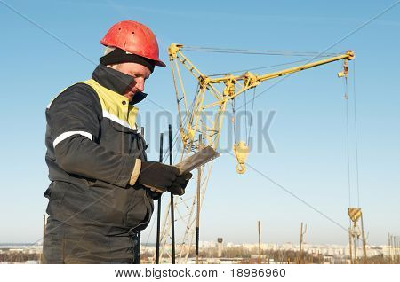 foreman worker in workwear at construction site