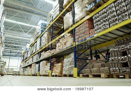 long stack arrangement of goods in a wholesale and retail warehouse depot