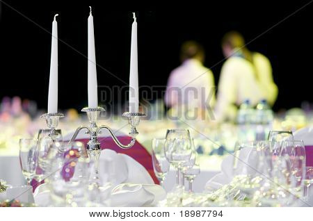 catering service table decoration with stemware and silverware restaurant setting for party