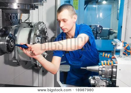mechanical technician operative of cnc milling cutting machine center at tool workshop