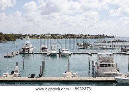 Jupiter FL USA - March 30 2017: Loxahatchee River boats docked in a marina on a mostly sunny day. Many boats parked in docks on the Loxahatchee River.