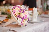 beautiful wedding boquet lying on table in restaurant