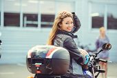 Постер, плакат: Girl In Moto Equipment With A Motorcycle