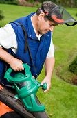 picture of leaf-blower  - Man with leaf blower - JPG