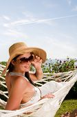 picture of woman beach  - Young woman in hammock - JPG