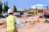 Asian Construction Engineer Checking Construction Site For New Infrastructure Project. Photo Concept poster