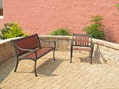 pic of fieldstone-wall  - Bench and chair sitting on a patio of a commercial site - JPG
