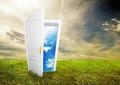 stock photo of open door  - Open door to new life on the field - JPG
