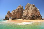 stock photo of cortez  - Beautiful Ocean and Arch with sand under the arch at Los Cabo Mexico - JPG
